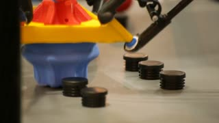 A Robot shows off its capabilities by picking items up, placing them down