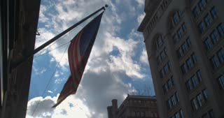 A slightly worn American Flag Blows in the wind in Midtown Manhattan