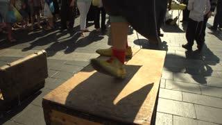 A Street Musicians Clown Shoe keeps the beat in Jerusalem
