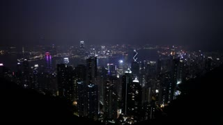 A wide night view of Hong Kong, looking down from the mountains