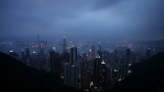 A wide view of Hong Kong on an overcast night looking down from the mountains