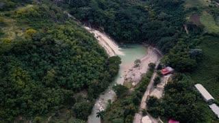 Aerial Drone Flies High over Haitian Waterfall