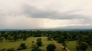 Aerial Drone travels over rural Haiti on a stormy day