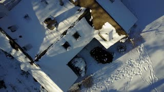 Aerial Top Down view of a Snow Covered House after a Blizzard