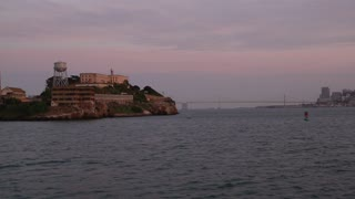 Alcatraz during a dramatic sunset View from boat.