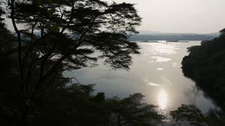 An african jungle & river vista sunset