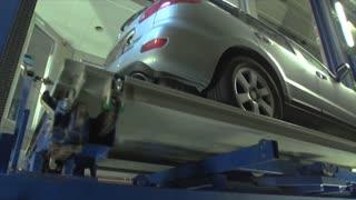 An automated mechanical/robotic service parks a car at a parking garage