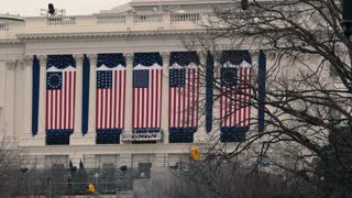 Contemporary and Historical US flags hang from the Capitol before Swearing In