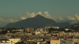 Dramatic mountain and clouds hover over the Geneva Skyline