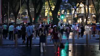 Heavy Pedestrian Traffic at Night in Singapore