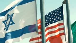 Israeli, American, and Italian Flags fly in a row in Slow Motion