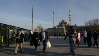 Istanbul's historic mosques hover pedestrians in Istanbul, Turkey