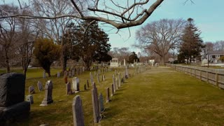 Old Cemetery low drone shot in East Hampton follows rows of graves