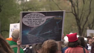 Protestor Holds a verbose, Titanic themed sign at the 2017 NYC March for Science