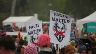 "Protestor swings a Einstein ""Facts Matter"" Sign at the March for Science"