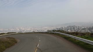San Francisco skyline vista from a curvy road atop the Twin Peaks