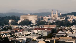 Skyline of San Francisco: Golden Gate bridge and St. Ignatius Cathedral Visible