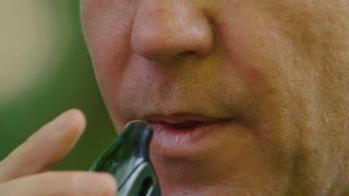 Slow motion 180fps: Vaping Man blows smoke in closeup
