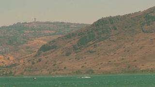 Speedboats dash along the Sea of Galilee