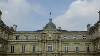 The French Flag and impressive architecture hang over Jardin du Luxembourg