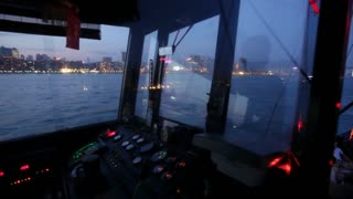 The pilot house and controls of a small boat cruising Victoria Harbour