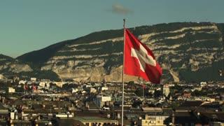 The Swiss Flag flies over Geneva Switzerland