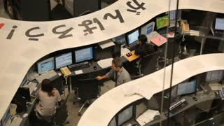 Traders during a Calm Day at the Tokyo Stock Exchange
