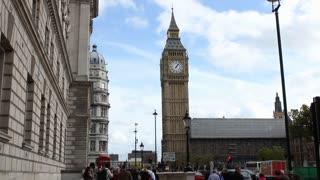 Traffic and Pedestrians flow around Big Ben clocktower in London
