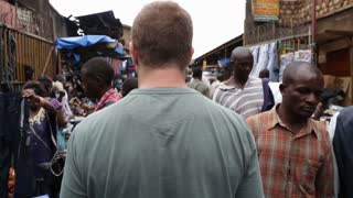 Walkthrough of a crowded and popular goods and food market in Uganda