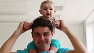 Dad has fun with a young child at home