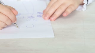 little girl is sitting at his desk at school - tracking shot