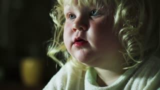 little girl stares cartoons