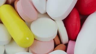pills rotate on white background. closeup