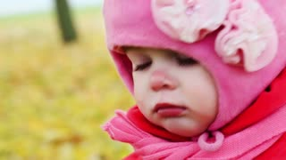 portrait of a little girl close-up in the autumn park, closeup, handheld shot