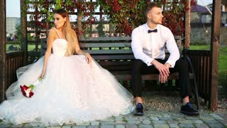 Romantic bride and groom posing outdoors