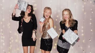 3 beautiful girls at a party dancing with gift boxes
