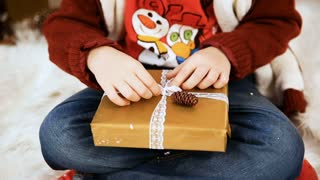boy open gifts in the Christmas interior indoors
