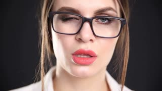 portrait of a beautiful sexy woman in glasses close-up on a black background