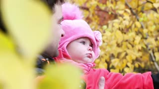 young Dad with a small child having fun in autumn park - closeup