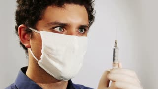 young doctor with a syringe closeup