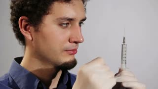 young doctor with a syringe