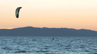 01 September, 2018. Vladivostok city, Russia. Kite-surfing against a beautiful sunset. Silhouette of kitesurfer. Holidays on nature. Artistic picture.