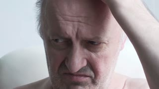 pensioner, looking, scratching a head