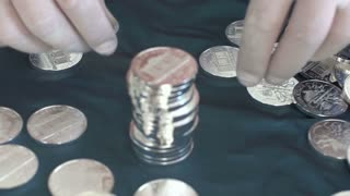 man with silver coins