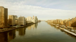 aerial view of east river and manhattan skyline. urban city background