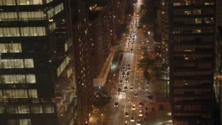 aerial view of illuminated city streets and traffic at night. modern buildings