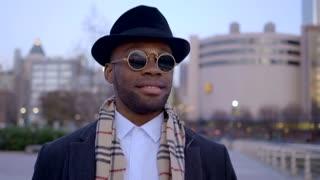 african american male model walking alone in the city
