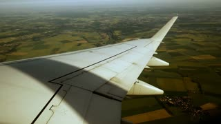 airplane. travel traveling. transportation. wing. window view