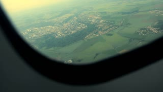 airplane window view. flight flying airborne. plane aircraft. in the air
