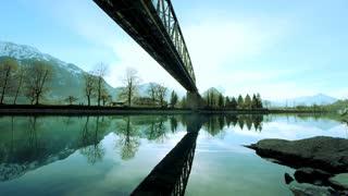amazing landscape panorama. water reflection. bridge over lake